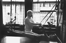 Joseph Pilates teaching a student